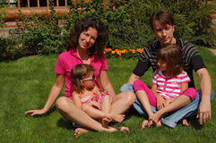 Family of four in the garden Stock Photo
