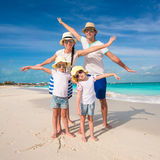 Family of four have fun on caribbean summer vacation Stock Photo