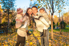 Family of four having fun in autumn park on a Royalty Free Stock Photography
