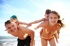 Family of four having fun at the beach. Stock Photography