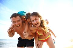 Family of four having fun at the beach. Royalty Free Stock Photography