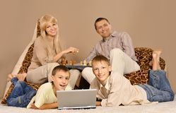 Family of four having fun Royalty Free Stock Image