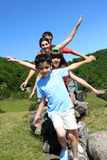 Family of four having fun on a hiking trip Royalty Free Stock Images