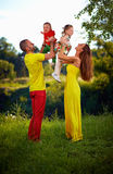 Family of four having fun outdoors Stock Photo