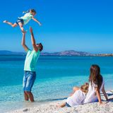 Family of four having fun during their tropical Stock Image
