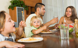 Family of four  having lunch with pasta Royalty Free Stock Photography