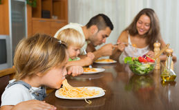 Family of four  having lunch with pasta Royalty Free Stock Image