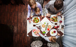 Family of four having meal at a restaurant. Young family of four having meal at a restaurant stock images