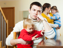 Family of four having quarrel at home Stock Photo
