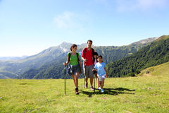Family of four hiking in beautiful mountain scenery Stock Photography