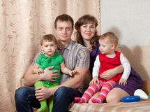 Family of four at home Royalty Free Stock Images