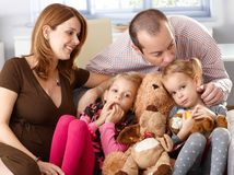 Family of four at home Royalty Free Stock Photo