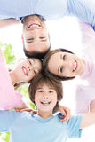 Family of four hugging each other Royalty Free Stock Photos