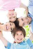 Family of four hugging each other Stock Images