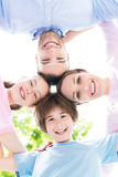 Family of four hugging each other Stock Photo
