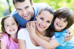 Family of four hugging each other Stock Image