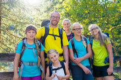Family with four kids hiking in the mountains Stock Images