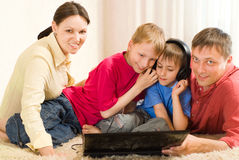 Family of four with a laptop Stock Images