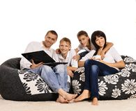 Family of four with laptop Stock Photo