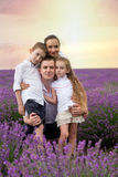 Family of four among lavender field Stock Images