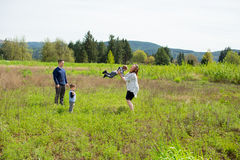 Family of Four Lifestyle Portrait. Lifestyle portrait of a family of four people outdoors in a natural field in Oregon Royalty Free Stock Image