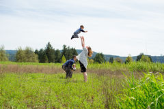 Family of Four Lifestyle Portrait. Lifestyle portrait of a family of four people outdoors in a natural field in Oregon Royalty Free Stock Photography