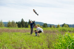 Family of Four Lifestyle Portrait. Lifestyle portrait of a family of four people outdoors in a natural field in Oregon Royalty Free Stock Photo