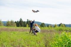Family of Four Lifestyle Portrait. Lifestyle portrait of a family of four people outdoors in a natural field in Oregon Royalty Free Stock Photos