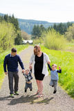 Family of Four Lifestyle Portrait. Lifestyle portrait of a family of four people outdoors in a natural field in Oregon Stock Images