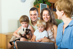 Family of four listening to the insurance agent Stock Photo