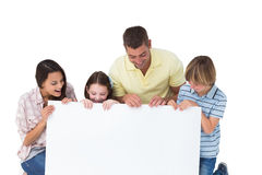 Family of four looking at billboard. Happy family of four looking at billboard over white background stock photo