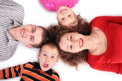 Family of four lying on floor royalty free stock photos