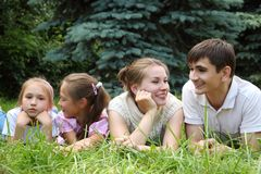 Family of four lying on grass Royalty Free Stock Images