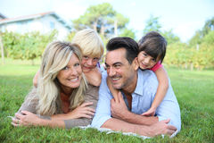 Family of four lying in grass Stock Photography
