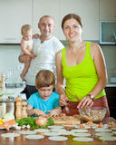Family of four making homemade ravioli stuffed with fish and dou Stock Photos