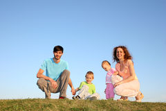 Family of four on meadow Stock Images