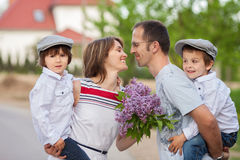 Family of four, mother, father and two boys, parent having the k Royalty Free Stock Photography