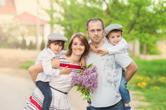 Family of four, mother, father and two boys, parent having the k Royalty Free Stock Photo