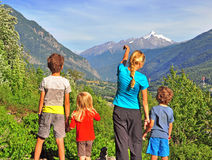 Family of four in mountains Stock Images