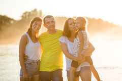 Family of four near the river outdoors during summertime Stock Images