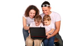Family of four with notebook Stock Photography