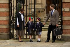 Family of four at old school gates Royalty Free Stock Image