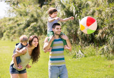 Family of four in park Royalty Free Stock Photo