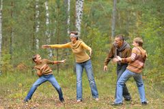 Family of four in park Royalty Free Stock Images
