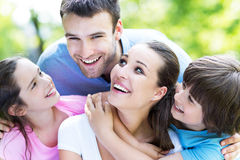Family of four in the park Stock Images