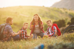 Family of four people eating fastfood in mountains Royalty Free Stock Photo