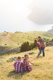 Family of four people looking to beautiful seascape in mountains Royalty Free Stock Image