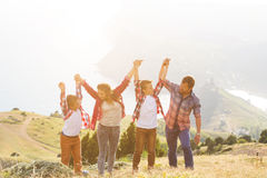 Family of four people looking to beautiful seascape in mountains Royalty Free Stock Photo