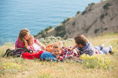 Family of four people looking to beautiful seascape in mountains Royalty Free Stock Photography