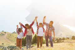 Family of four people looking to beautiful seascape in mountains Stock Photography